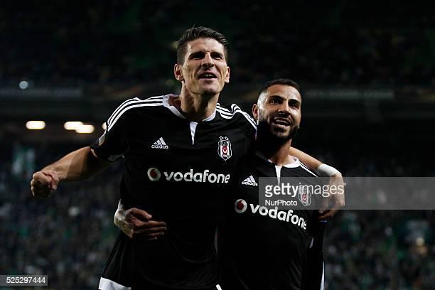 Besiktas's forward Mario Gomez celebrates his goal with Besiktas's midfielder Quaresma during the UEFA Europa League football match between Sporting...