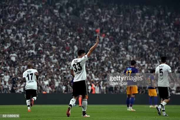 Besiktas's German forward Mario Gomez celebrates with his team mates after scoring a goal during the Turkish Spor Toto Super league football match...