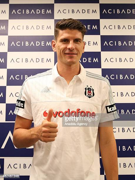 Besiktas's new transfer German footballer Mario Gomez poses as he undergoes a medical examination at a hospital on July 31 2015 in Istanbul Turkey