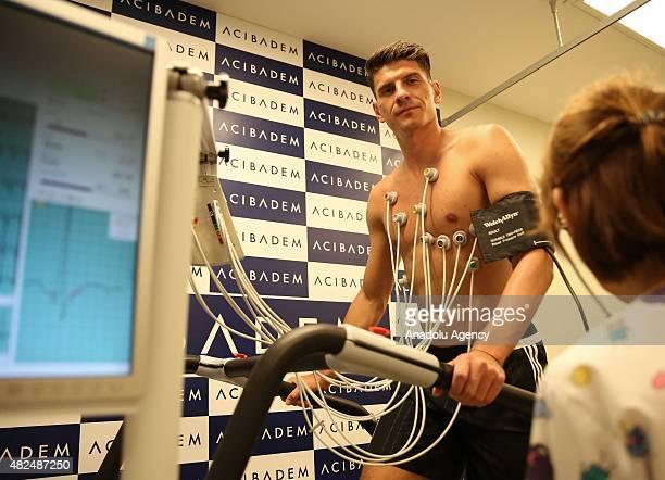 Besiktas's new transfer German footballer Mario Gomez undergoes a medical examination at a hospital on July 31 2015 in Istanbul Turkey