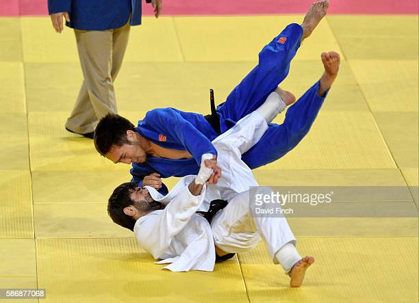 Beslan Mudranov of Russia attacks Yeldos Smetov of Kazakhstan eventually defeating him for the under 60kg gold medal during day 1 of the 2016 Rio...
