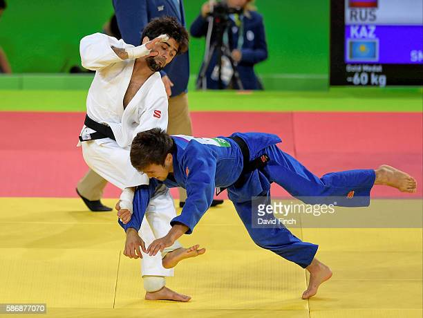 Beslan Mudranov of Russia attacks Yeldos Smetov of Kazakhstan with a leg sweep eventually defeating him for the under 60kg gold medal during day 1 of...