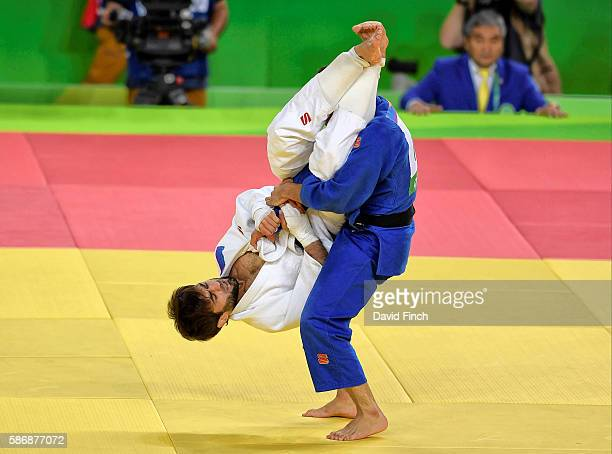 Beslan Mudranov of Russia attacks Yeldos Smetov of Kazakhstan with a flying armlock eventually defeating him for the under 60kg gold medal during day...