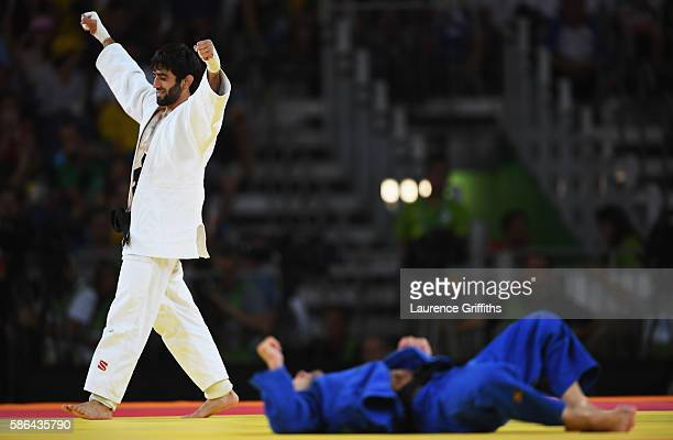 Beslan Mudranov of Russia celebrates after defeating Amiran Papinashvili of Georgia during the men's 60kg judo contest on Day 1 of the Rio 2016...