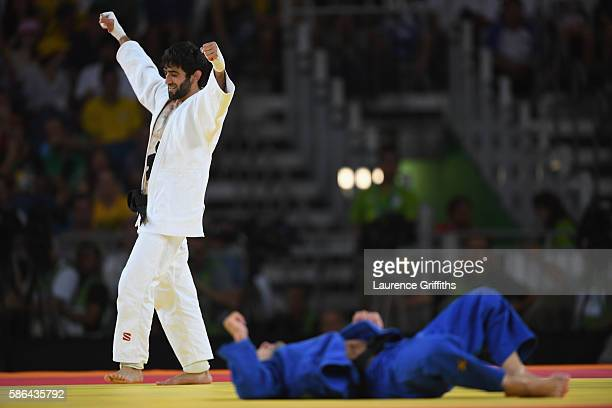 Beslan Mudranov of Russia celebrates after defeating Amiran Papinashvili of Georgia during the men's -60kg judo contest on Day 1 of the Rio 2016...