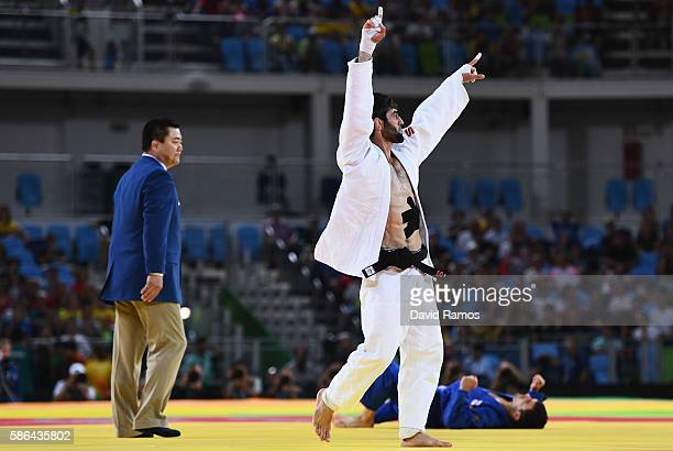 Beslan Mudranov of Russia celebrates after defeating Amiran Papinashvili of Georgia during the Men's -60k Semifinal of Table A Judo contest on Day 1...