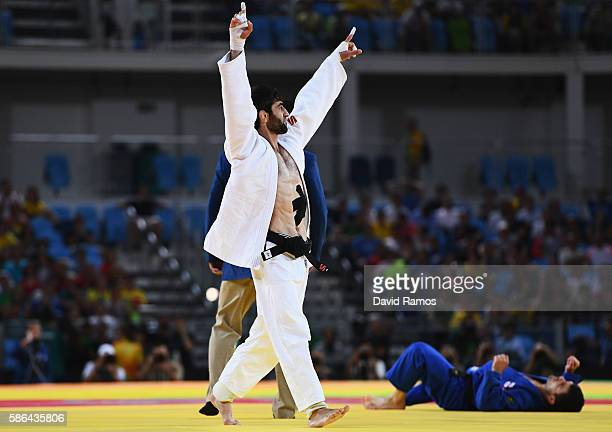 Beslan Mudranov of Russia celebrates after defeating Amiran Papinashvili of Georgia during the Men's 60k Semifinal of Table A Judo contest on Day 1...