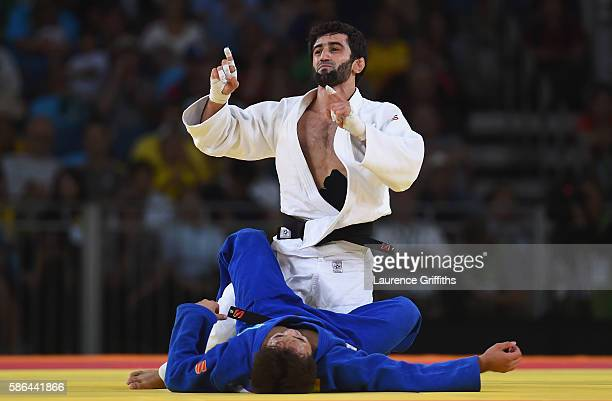 Beslan Mudranov of Russia celebrates after defeating Yeldos Smetov of Kazakhstan in the Men's -60 kg Gold Medal contest on Day 1 of the Rio 2016...