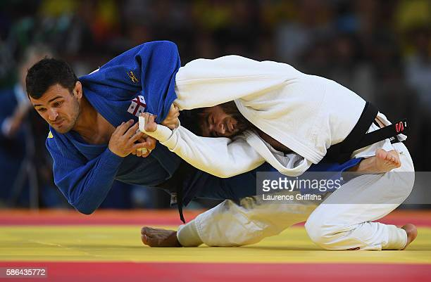 Beslan Mudranov of Russia competes against Amiran Papinashvili of Georgia during the men's -60kg judo contest on Day 1 of the Rio 2016 Olympic Games...