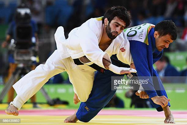 Beslan Mudranov of Russia competes against Amiran Papinashvili of Georgia during the Men's -60k Semifinal of Table A Judo contest on Day 1 of the Rio...