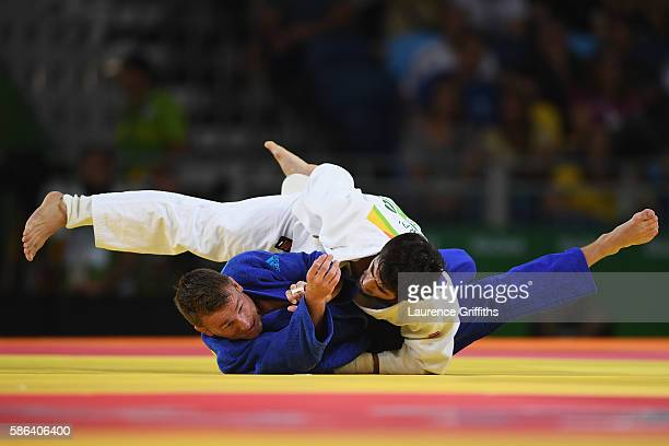 Beslan Mudranov of Russia competes against Jeroen Mooren of the Netherlands in the Men's -60 kg Judo on Day 1 of the Rio 2016 Olympic Games at...
