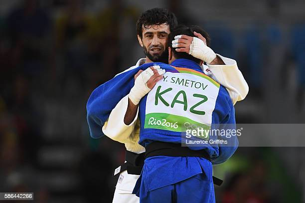 Beslan Mudranov of Russia consoles Yeldos Smetov of Kazakhstan after defeating him in the Men's -60 kg Gold Medal contest on Day 1 of the Rio 2016...