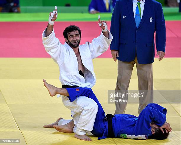 Beslan Mudranov of Russia happily rises from the mat after defeating Yeldos Smetov of Kazakhstan for the under 60kg gold medal during day 1 of the...