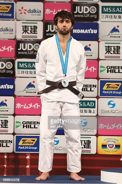Beslan Mudranov of Russia poses for photo on the podium after the Men's 60kg final at Tokyo Metropolitan Gymnasium on December 4, 2015 in Tokyo,...