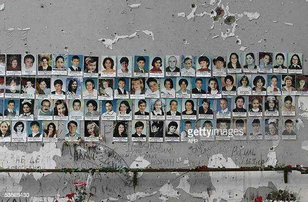 A picture made 31 August 2005 shows portraits on the wall of school of some of the victimes of the Beslan crisis that erupted on September 1 the...