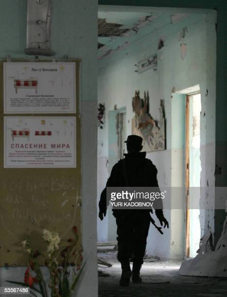 A Russian military combat engineer searches a corridor in the destroyed school of Beslan 31 August 2005 Russians will commemorate victims of the act...