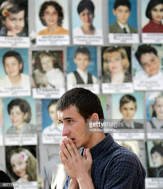 A victim's relative mourns at the sport hall of Beslan's school 01 September 2005 during the commemoration of the Beslan massacre that left 318...