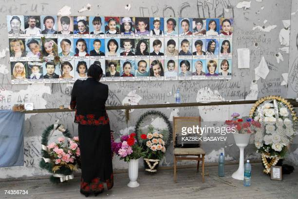 A woman stands near chidren's pictures in the destroyed school sport hall in Beslan 30 May 2007 Beslan holds a mourning action organized by the...