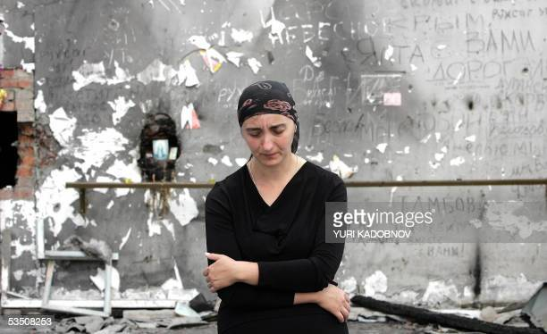 Ludmila Dzgyeva who lost a daughter during the Beslan hostage drama in the town of Beslan 03 September 2004 stands in the destroyed school sports...