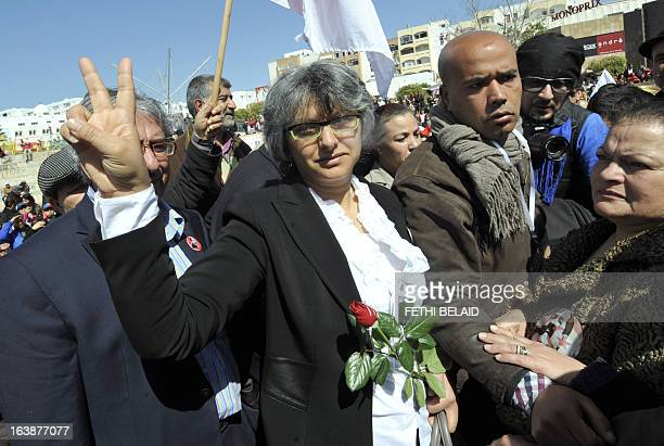Besma Khalfaoui the widow of slain Tunisian opposition leader Chokri Belaid makes the victory sign as she joins Tunisians marking 40 days since the...