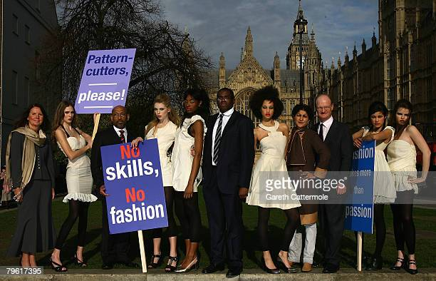 Bespoke tailor Imtaz Khaliq MPs David Lammy and David Willetts and Linda Florance chief executive of SkillfastUK pose with models as they protest in...