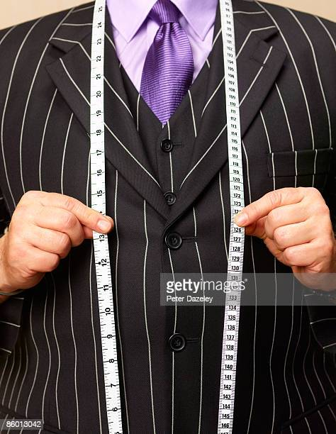 bespoke tailor with tape measure. - instrument of measurement stock pictures, royalty-free photos & images