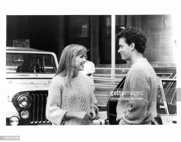 Bess Armstrong and Tom Hanks talk in the street in a scene from the film 'Nothing In Common' 1986