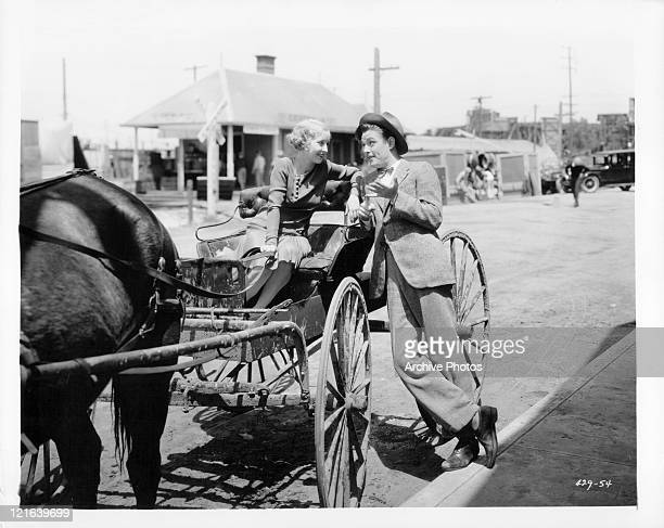 Bessie Love and Eddie Nugent having conversation in horse drawn carriage in a scene from the film 'The Girl In The Show' 1929