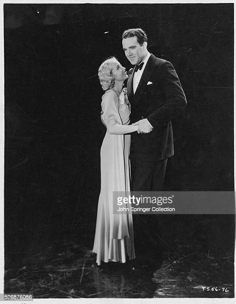 Bessie Love and John Holland in a scene from the motion picture Morals for Women