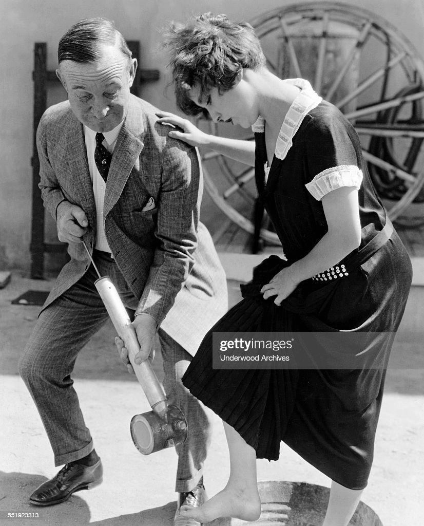 Actress Gets Feet Sprayed : News Photo