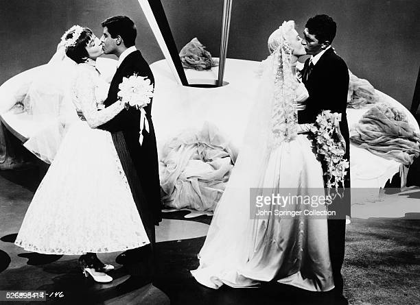 Bessie Sparrowbrush kisses Eugene Fullstack and Abigail Parker kisses Rick Todd in the 1955 version of the musical comedy Artists and Models