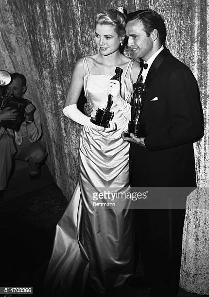 Best actor and actress of the 1954 screen season stand clutching their Oscars after the Academy Award presentations March 30th Grace Kelly won for...