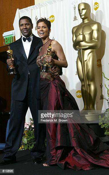 Best Actor and Actress winners Halle Berry and Denzel Washington pose with their awards backstage during the 74th Annual Academy Awards March 24 2002...