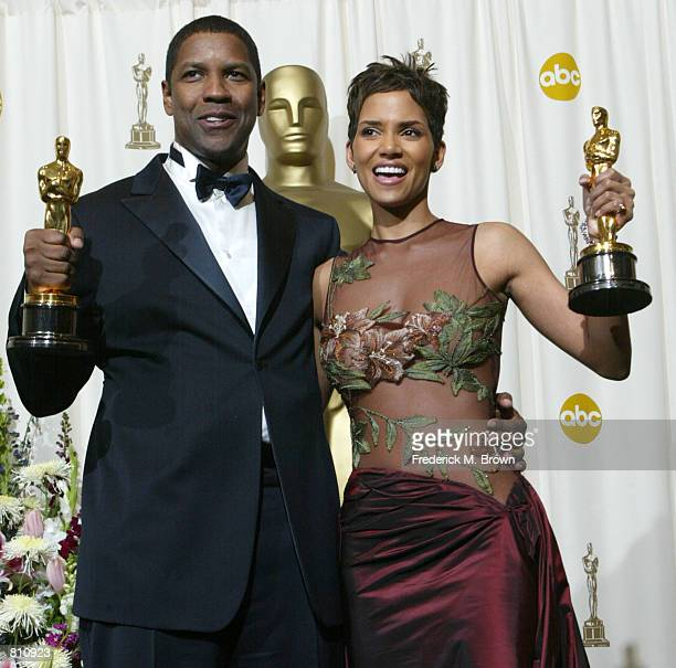 Best Actor and Actress winners Halle Berry and Denzel Washington pose with their Oscars backstage during the 74th Annual Academy Awards March 24 2002...