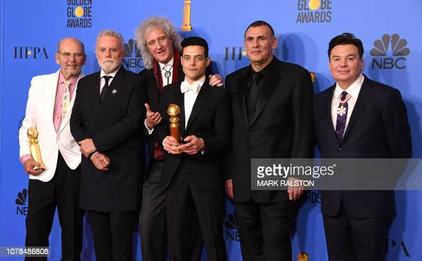 TOPSHOT Best Actor in a Motion Picture Drama for Bohemian Rhapsody winner Rami Malek poses with Graham King Brian May and Mike Myers in the press...
