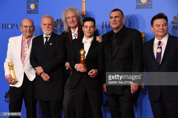 Best Actor in a Motion Picture Drama for Bohemian Rhapsody winner Rami Malek poses with Graham King Brian May and Mike Myers in the press room during...