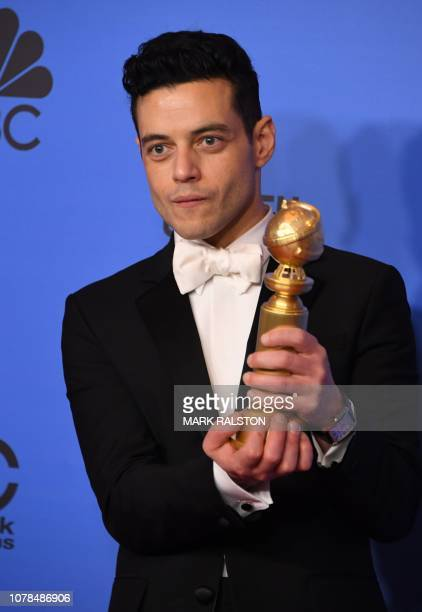 TOPSHOT Best Actor in a Motion Picture Drama for Bohemian Rhapsody winner Rami Malek poses with the trophy during the 76th annual Golden Globe Awards...