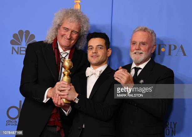 TOPSHOT Best Actor in a Motion Picture Drama for Bohemian Rhapsody winner Rami Malek poses with Queen band members Roger Taylor and Brian May during...