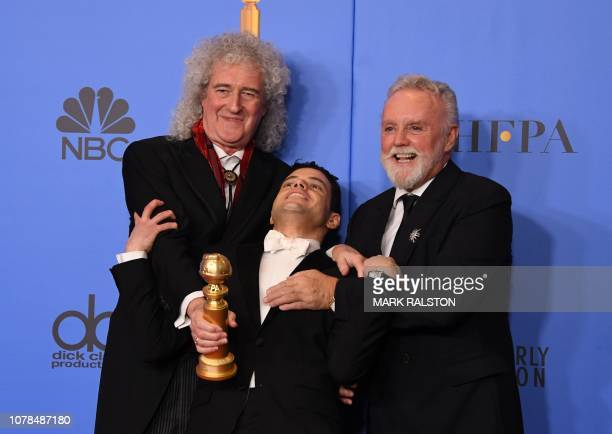 Best Actor in a Motion Picture Drama for Bohemian Rhapsody winner Rami Malek poses with Queen band members Roger Taylor and Brian May during the 76th...
