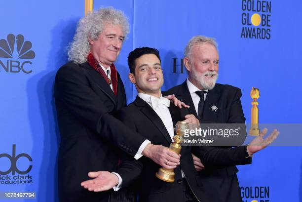 Best Actor in a Motion Picture Drama for 'Bohemian Rhapsody' winner Rami Malek with Brian May and Roger Taylor of Queen pose in the press room during...