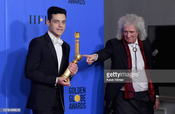 Best Actor in a Motion Picture Drama for 'Bohemian Rhapsody' winner Rami Malek and Brian May of Queen poses in the press room during the 76th Annual...