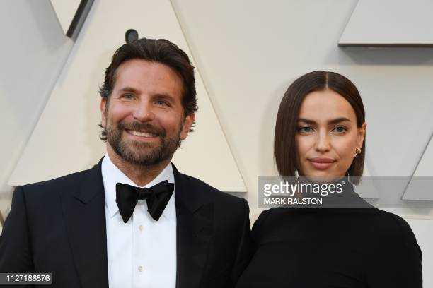 Best Actor nominee for A Star is Born Bradley Cooper and his wife Russian model Irina Shayk arrive for the 91st Annual Academy Awards at the Dolby...