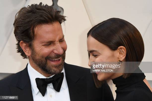 TOPSHOT Best Actor nominee for A Star is Born Bradley Cooper and his wife Russian model Irina Shayk arrive for the 91st Annual Academy Awards at the...