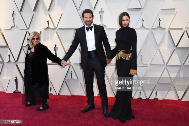Best Actor nominee for A Star is Born Bradley Cooper his wife Russian model Irina Shayk and his mom Gloria Campano arrives for the 91st Annual...