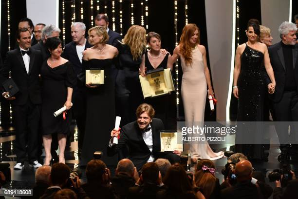 TOPSHOT Best Actor prize laureate US actor Joaquin Phoenix Best Screenplay colaureate British director Lynne Ramsay Grand Prix laureate French...