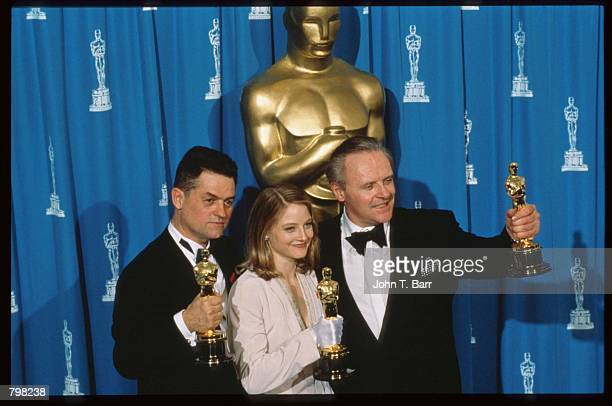 Best Actor recipient Anthony Hopkins Best Actress recipient Jodie Foster and Best Director recipient Jonathan Demme hold their Oscars at the 64th...