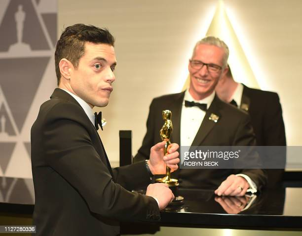 Best Actor winner for Bohemian Rhapsody Rami Malek get his Oscar carved as he attends the 91st Annual Academy Awards Governors Ball at the Hollywood...