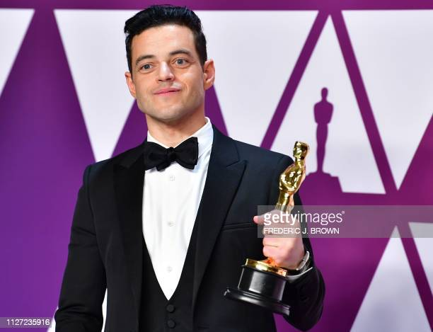 TOPSHOT Best Actor winner for Bohemian Rhapsody Rami Malek poses in the press room during the 91st Annual Academy Awards at the Dolby Theatre in...