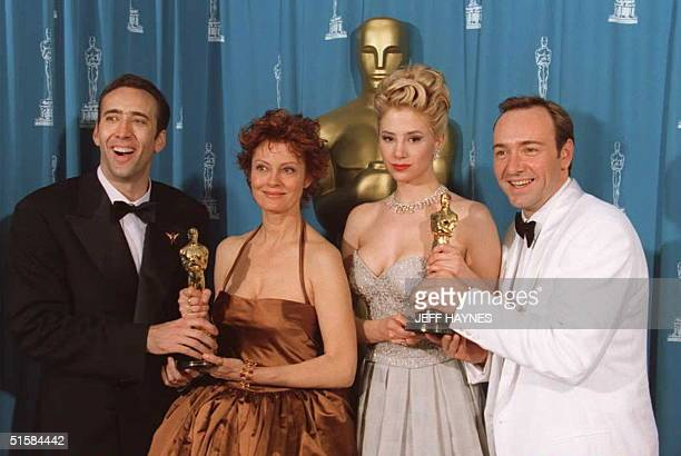 Best Actor winner Nicolas Cage Best Actress Susan Sarandon Best Supporting Actress Mira Sorvino and Best Supporting Actor Kevin Spacey pose while...