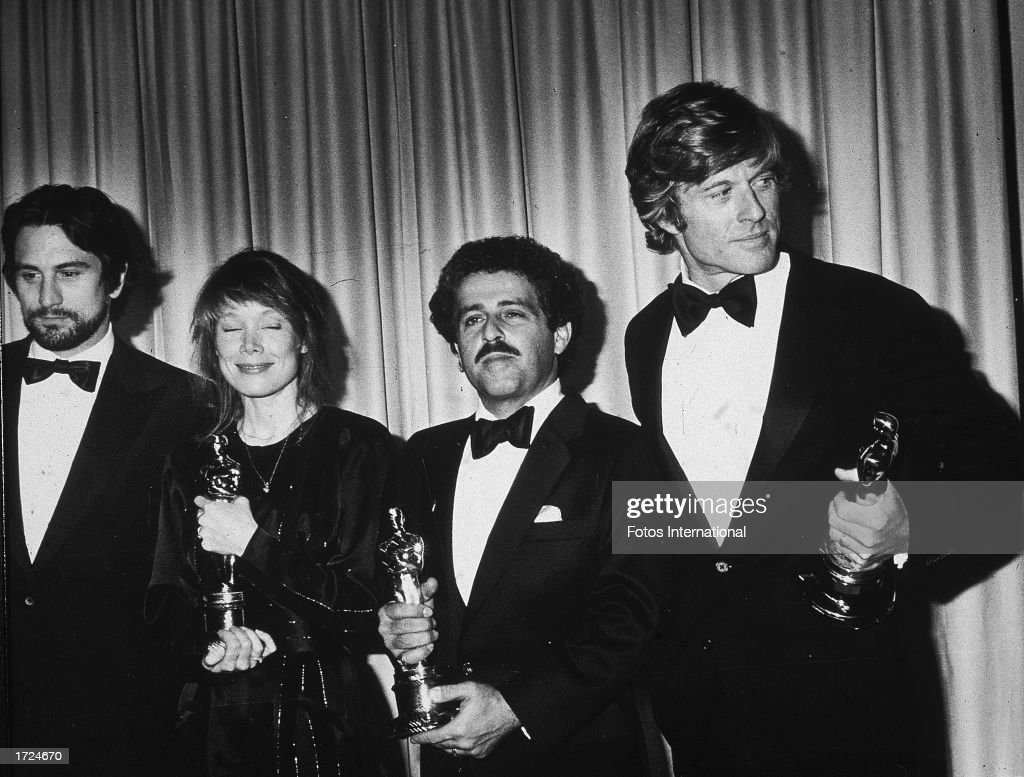 Best Actor winner Robert DeNiro ('Raging Bull'), Best Actress winner Sissy Spacek ('Coal Miner's Daughter'), Robert L. Schwary, producer of the Best Picture ('Ordinary People'), and Best Director winner Robert Redford ('Ordinary People') hold their Oscar statuettes backstage at the Academy Awards, Dorothy Chandler Pavilion, L.A. County Music Center, Los Angeles, California, March 31, 1981.